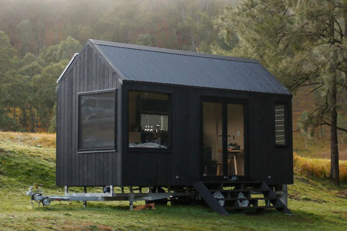 Tiny house features all-black exterior and solar power - Curbed on home mobile home, electric mobile home, siding mobile home, residential mobile home, de markies mobile home, antique vintage mobile home, universal mobile home, heat pumps mobile home, water mobile home, gutters mobile home, windows mobile home, hybrid mobile home, double roof on mobile home, real estate mobile home, steel mobile home, earth mobile home, flooring mobile home, green mobile home, insulation mobile home, natural gas mobile home,