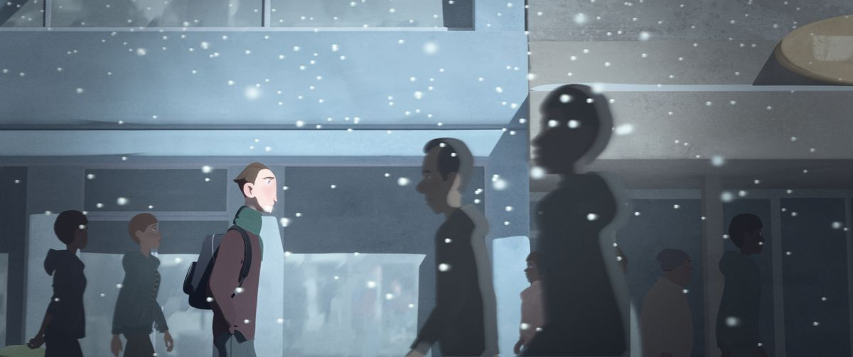 a young man walking home as snow falls