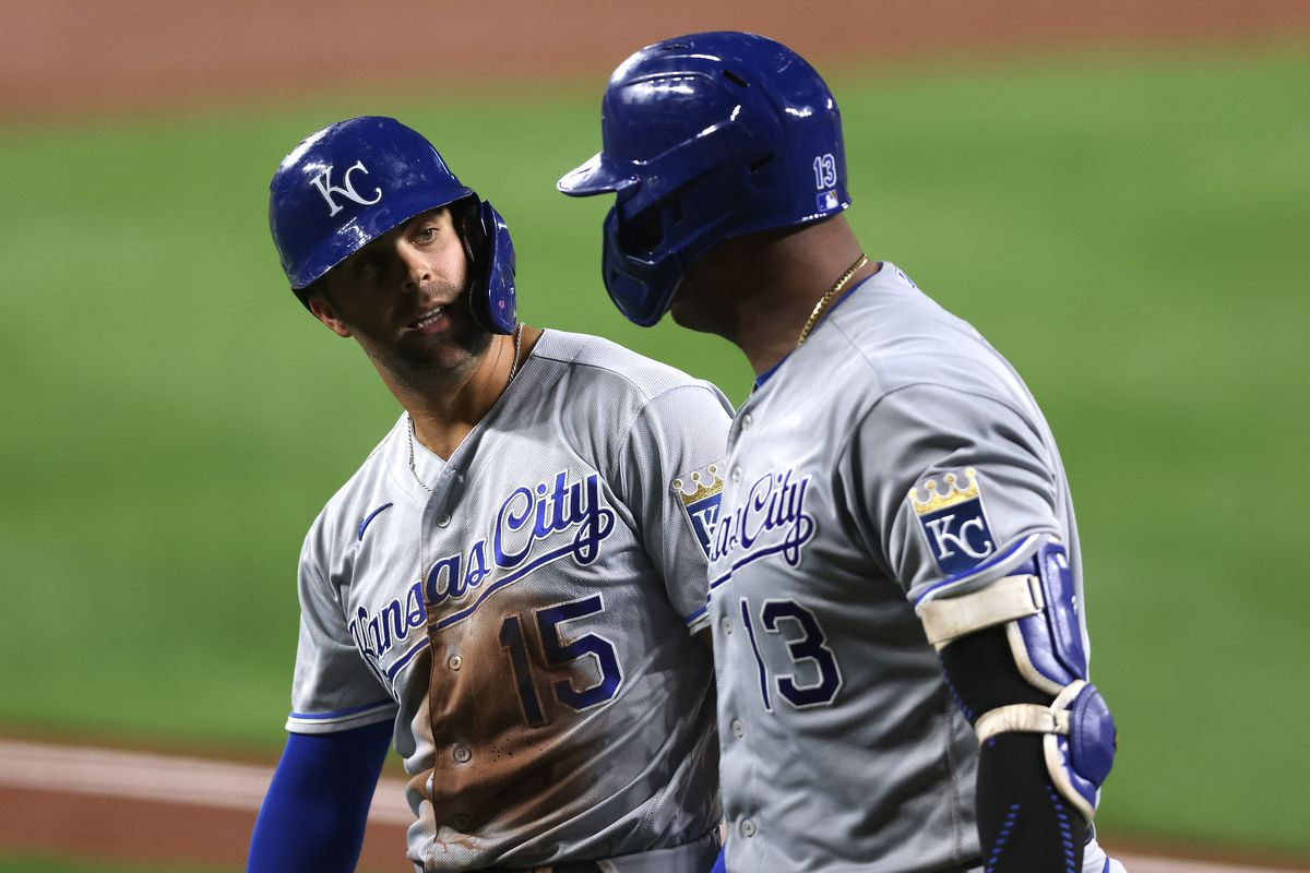 Whit Merrifield #15 talks with Salvador Perez #13 of the Kansas City Royals after scoring a run in the third inning against the Baltimore Orioles at Oriole Park at Camden Yards on September 08, 2021 in Baltimore, Maryland.