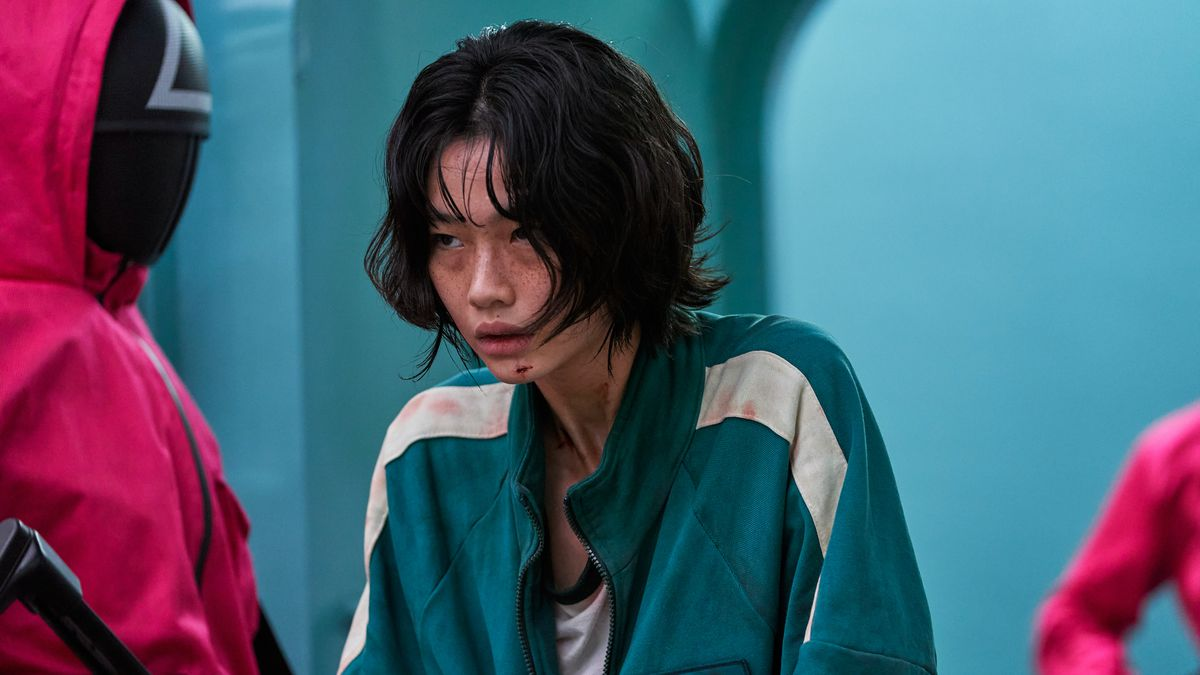 Jung Hoyeon as Player 067, Kang Sae-byeok, looking sweaty and overwhelmed in the Korean drama Squid Game