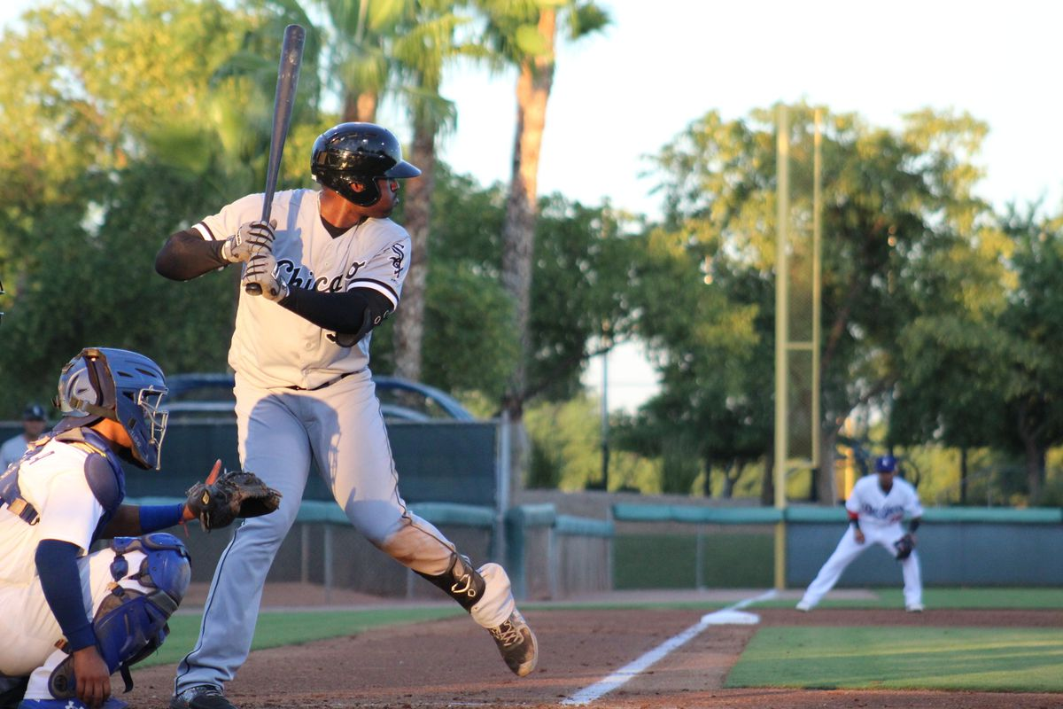 Micker Adolfo bats at a low-level facility, pic from the open side