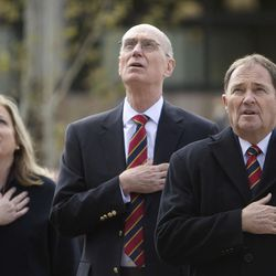 Joan Fenton, left, President Henry B. Eyring, first counselor in the First Presidency of the Church of Jesus Christ of Latter-day Saints, center, and Gov. Gary Herbert recite the Pledge of Allegiance at a flag ceremony before President Eyring dedicated the Thomas S. Monson Lodge at the Hinckley Scout Ranch in the Uinta Mountains on Wednesday, Oct. 5, 2016.