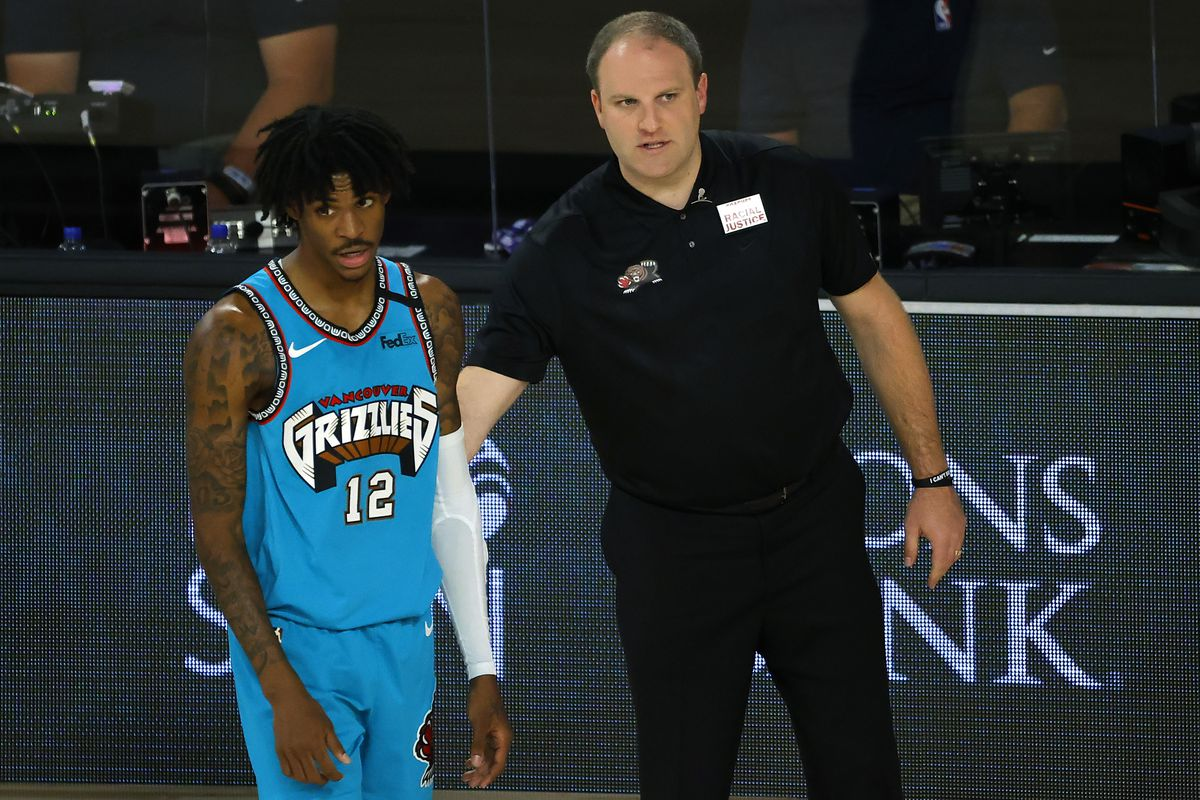 Ja Morant and head coach Taylor Jenkins of the Memphis Grizzlies look on against the Utah Jazz during the second half at HP Field House at ESPN Wide World Of Sports Complex on August 5, 2020 in Lake Buena Vista, Florida.