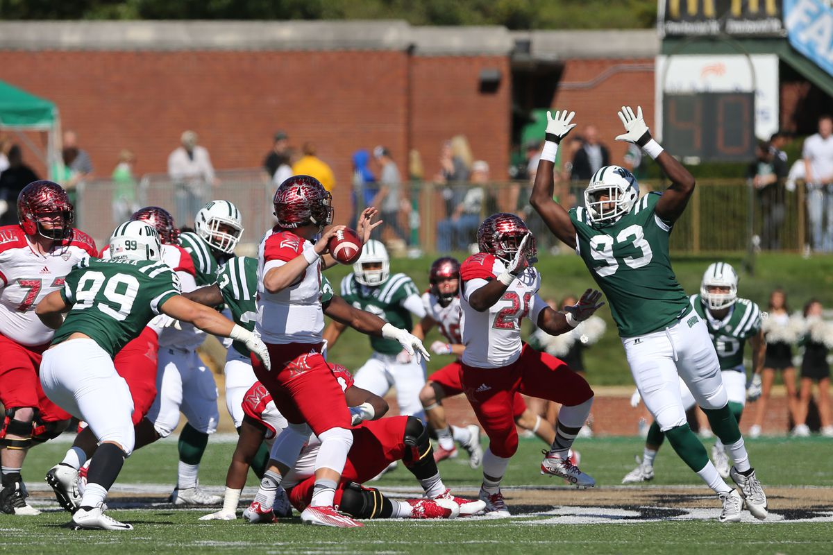 Tarell Basham leaps to block a pass by Billy Bahl in last year's Battle of the Bricks.