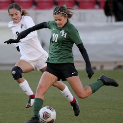 Rowland Hall's Summer Connery kicks the ball in front of Real Salt Lake Academy's Maci Nell during the 2A girls soccer championship game at Rio Tinto Stadium in Sandy on Monday, Oct. 26, 2020. Rowland Hall won 3-2.