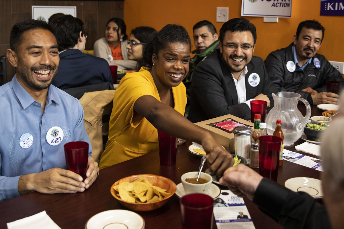 About a week before the March Primary, Cook County State's Attorney Kim Foxx fist bumps a supporter during a campaign stop at Cecina Grill in Pilsen.