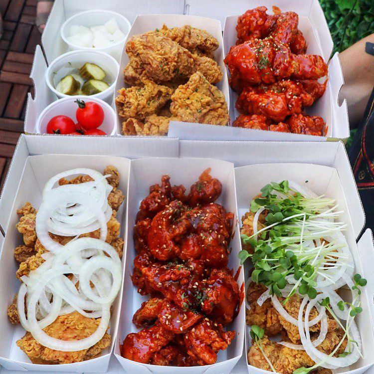 Paper trays filled with chicken wings