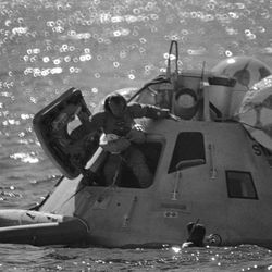 Capt. James A. Lovell Jr., commander of the Apollo 8 spaceflight, leaps from a mock-up of the command module into a rubber raft during egress training exercise in the Gulf of Mexico on Oct. 25, 1968 in Houston. The Apollo 8 crew, scheduled for orbital flight in December, went through the exercise while the crew of Apollo 7 was undergoing debriefing sessions following their successful orbital flight which ended early this week.