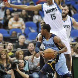 Minnesota Timberwolves' Anthony Randolph (15) defends Memphis Grizzlies' Mike Conley during the first half of an NBA basketball game Tuesday, April 17, 2012, in Minneapolis.