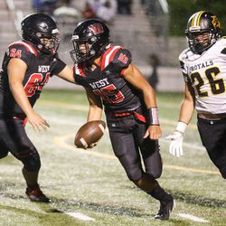 West's Isaiah Suesue (15) runs past Roy's Alex Johnson (26) during a high school football game Friday, Sept. 10, 2021, at West High School in Salt Lake City.