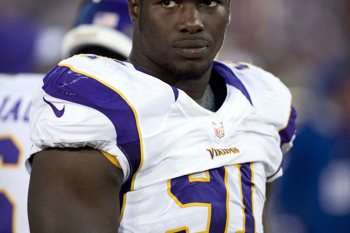 D'Aundre Reed models the new 'Leisure Suit Larry' look the Vikings are sporting with the road uniforms