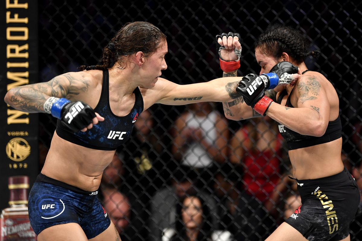 Germaine de Randamie of Netherlands punches Amanda Nunes of Brazil in their UFC women's bantamweight championship bout during the UFC 245 event at T-Mobile Arena on December 14, 2019 in Las Vegas, Nevada.