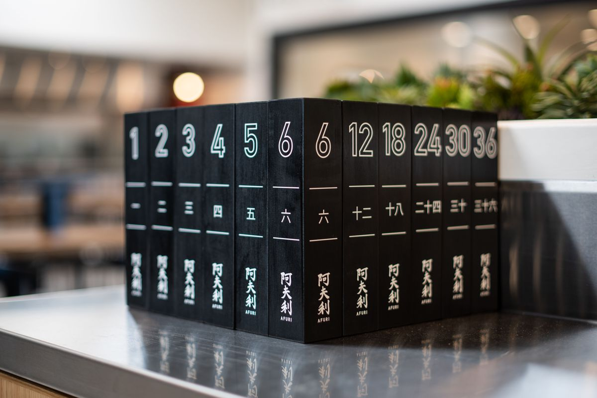 Black blocks for table seatings and orders at Afuri lined up into a cube in Los Angeles.
