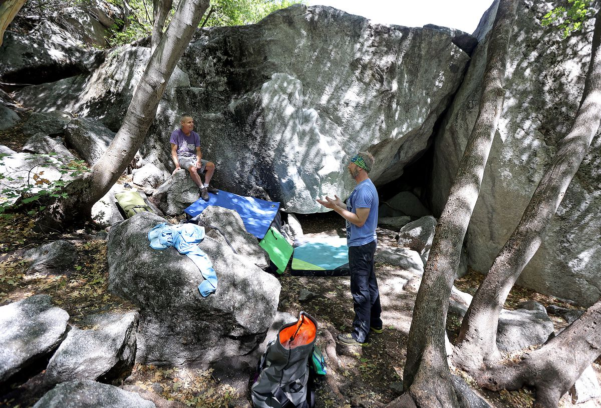 Eric Zschiesche and Paul Jones chat after bouldering at the Gate Buttress Boulders in Little Cottonwood Canyon on Monday, Aug. 23, 2021.