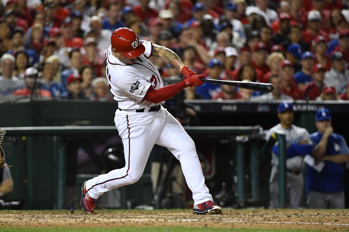 Washington Nationals player Asdrubal Cabrera hits a sacrifice fly scoring left fielder Juan Soto in the sixth inning against the Los Angeles Dodgers in game three of the 2019 NLDS playoff baseball series at Nationals Park.