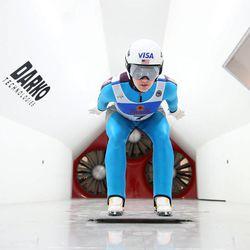 Women's Ski Jumping USA team member Abby Hughes practices an in-run position inside a wind tunnel built by Layne Christensen, founder of Darko Technologies, in Ogden's Business Depot on Thursday, Sept. 26, 2013.