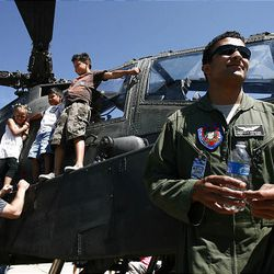 Spectators check out an Apache helicopter on Saturday at the Hill Air Force Base air show.