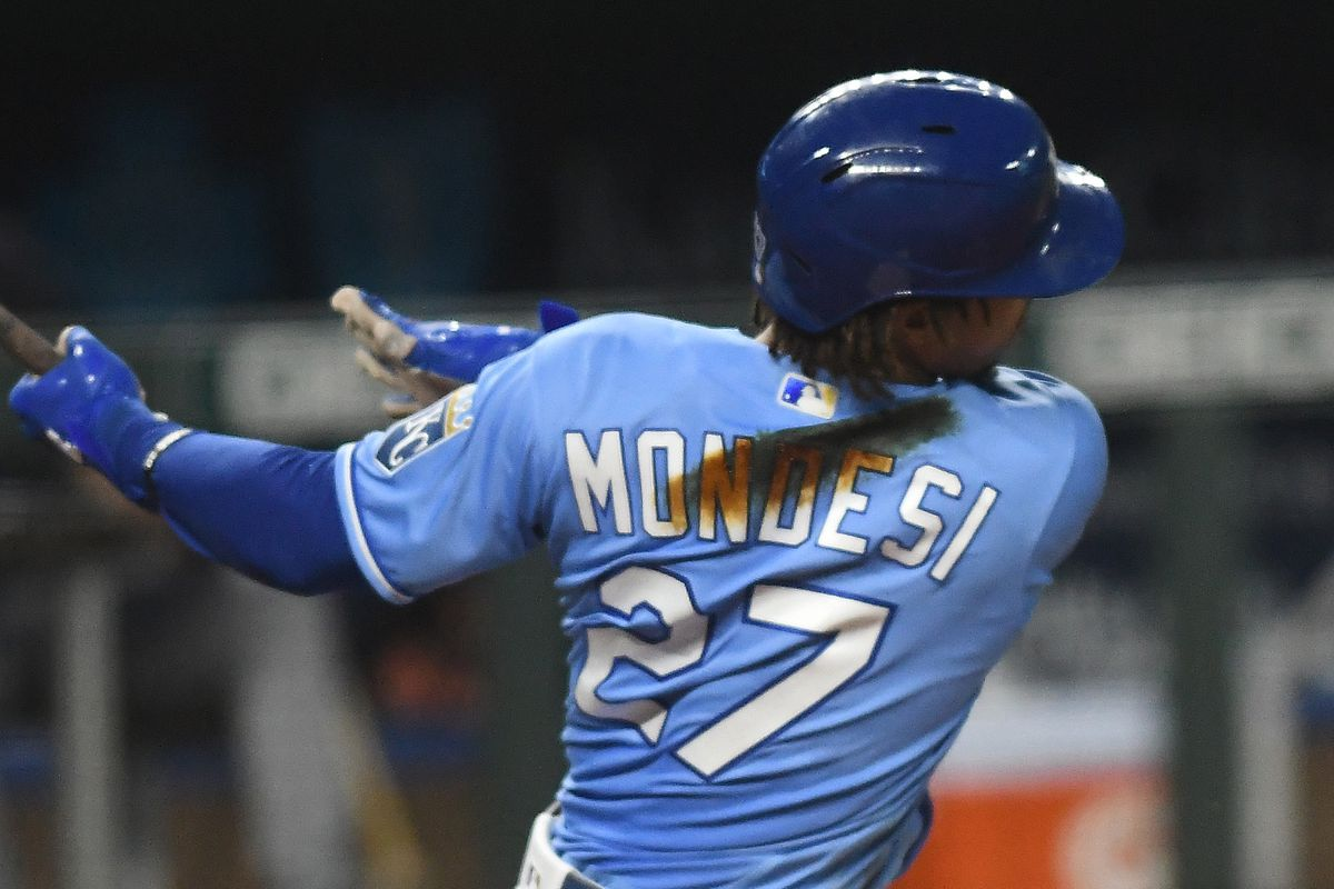Kansas City Royals infielder Adalberto Mondesi (27) shows the slash of pine tire on the back of his uniform that all Royals' players wore as a tribute to Kansas City Royals leftfielder Alex Gordon (4) who announced his retirement at the end of the season during a Major League Baseball game between the Detroit Tigers and the Kansas City Royals on September 26, 2020, at Kauffman Stadium, Kansas City, MO.