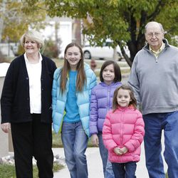 Don and Margaret Peterson with their grandchildren, Lauren, Chelsea and Lindsey Peterson, left to right,  who come to their house frequently to do crafts Friday, Nov. 18, 2011, in Draper, Utah.