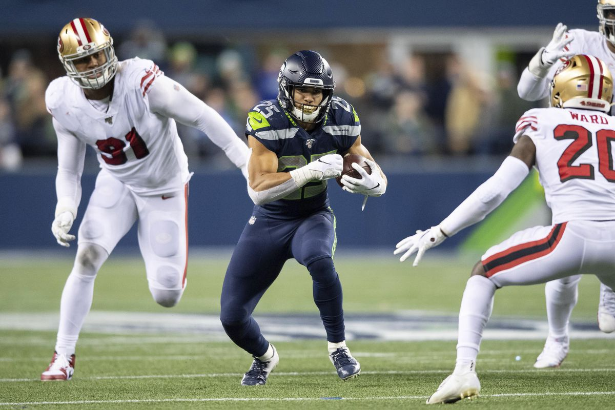 Seattle Seahawks running back Travis Homer carries the ball against the San Francisco 49ers during the second half at CenturyLink Field. San Francisco defeated Seattle 26-21.