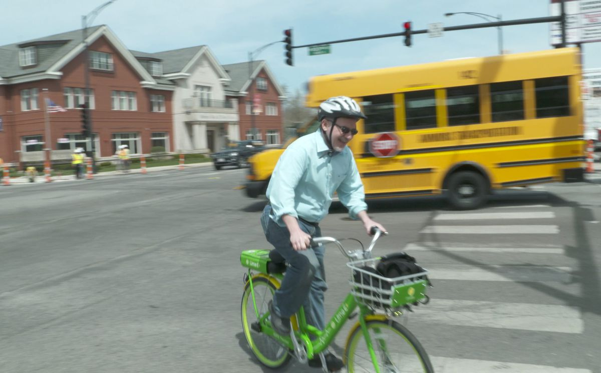 Chicago Sun-Times columnist Neil Steinberg tried out the new Lime Bike on 103rd street in May.   Eliza Davidson/Sun-Times