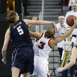 Nebraska's Hailie Sample (3) gets her shot blocked by BYU's Jennifer Hamson (5) during the first half of a second-round game in the NCAA women's college basketball tournament on Monday, March 24, 2014, in Los Angeles.