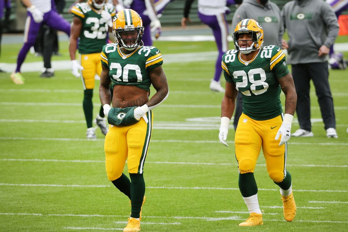Jamaal Williams #30 of the Green Bay Packers and AJ Dillon #28 of the Green Bay Packers warm up prior to the start of the game against the Minnesota Vikings at Lambeau Field on November 01, 2020 in Green Bay, Wisconsin.