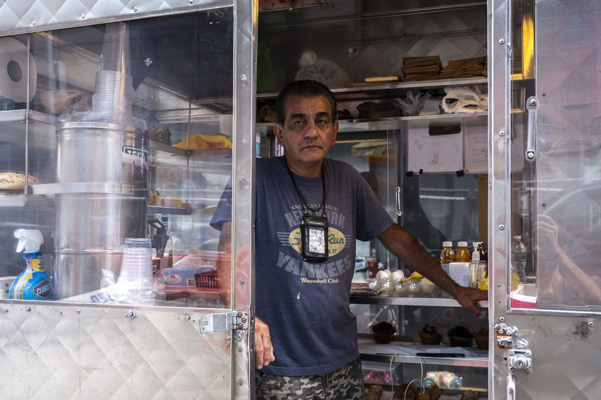 Bashir Saleh in his coffee and pastries food cart on West 43rd Street, a stone's throw away from the Hard Rock Café.