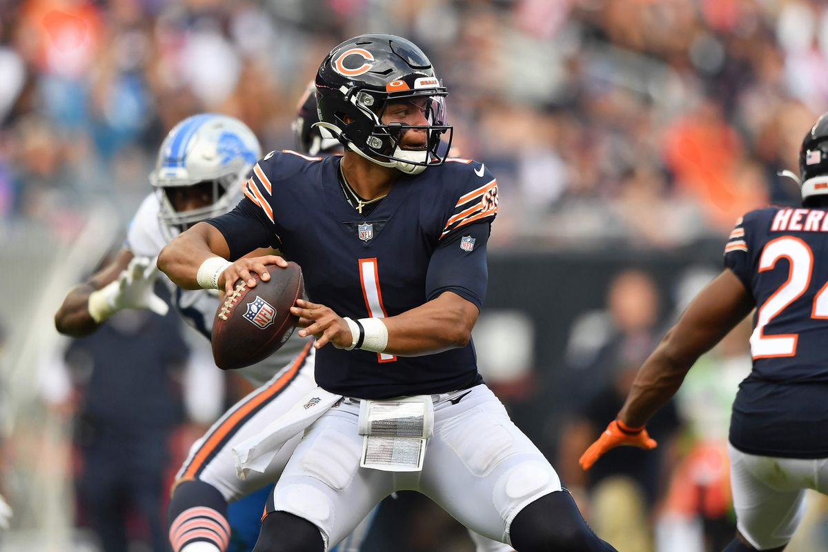 Quarterback Justin Fields #1 of the Chicago Bears passes against the Detroit Lions at Soldier Field on October 03, 2021 in Chicago, Illinois.