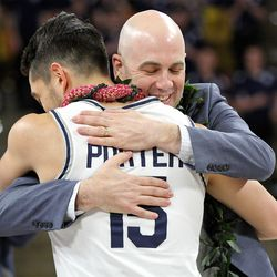 USU coach Craig Smith embraces Aggie guard Abel Porter during Senior Night activities at the Spectrum on Feb. 25.