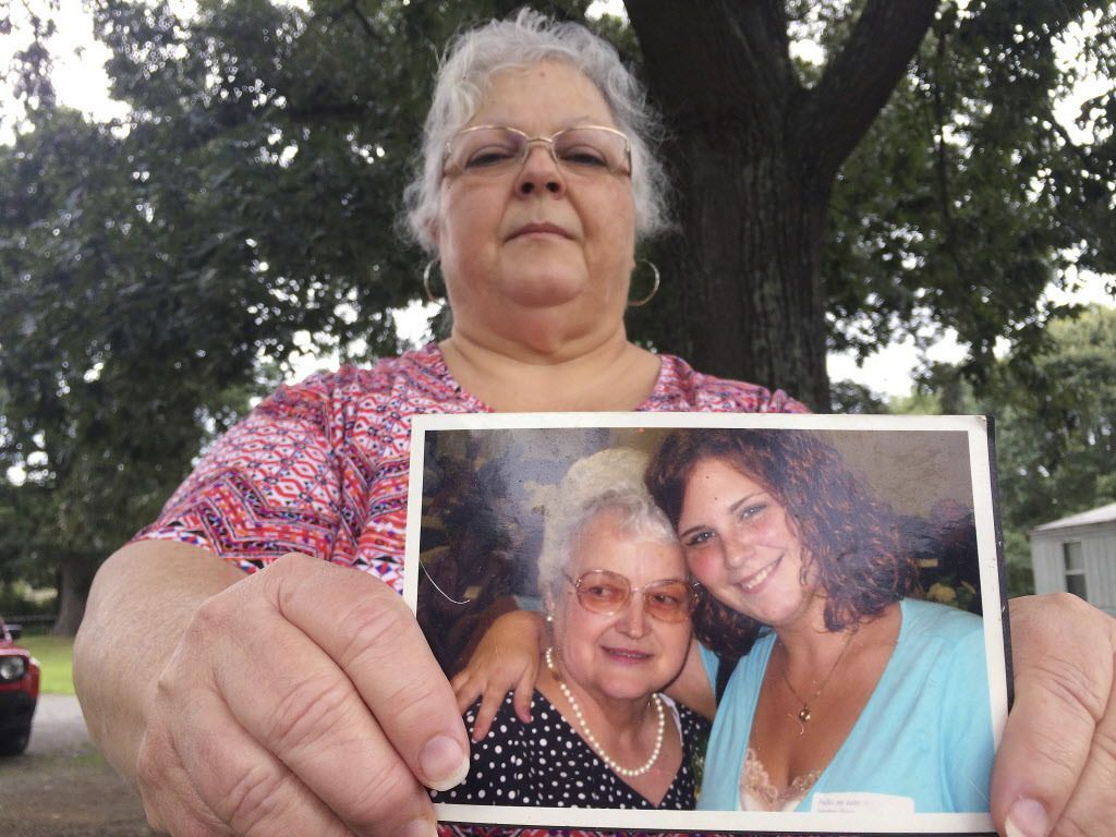Susan Bro, the mother of Heather Heyer, holds a photo of her and her daughter, on Monday, Aug. 14, 2017, in Charlottesville, Virginia.   Joshua Replogle/AP
