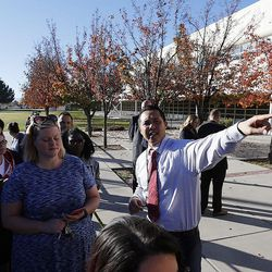 Principal Taran Chun of Mountain View High School directs parents to their children in Orem on Tuesday, Nov. 15, 2016, after five students were stabbed in an apparent attack by a 16-year-old boy.