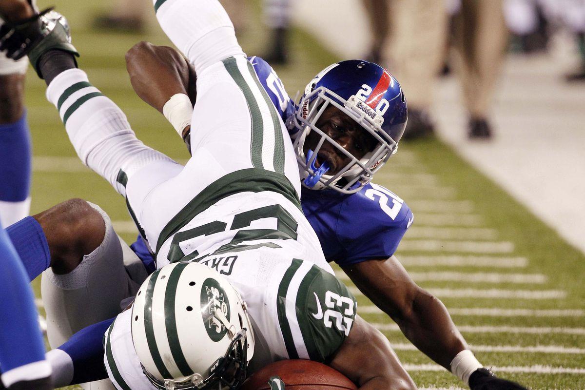 New York Giants cornerback prince Amukamara tackles Jets running back shonn greene Saturday at Metlife Stadium. William Perlman/THE STAR-LEDGER via US PRESSWIRE