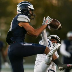 Hunter's Nathan Suaste (11) nearly catches the ball against Westlake's Cooper Cowan (3) during a high school football playoff game at Hunter High School in West Valley City on Friday, Oct. 23, 2020.