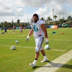 Jul 24, 2013; Davie, FL, USA; Miami Dolphins defensive end Jared Odrick (98) walks off the field after training camp practice at the Doctors Hospital Training Facility at Nova Southeastern University.