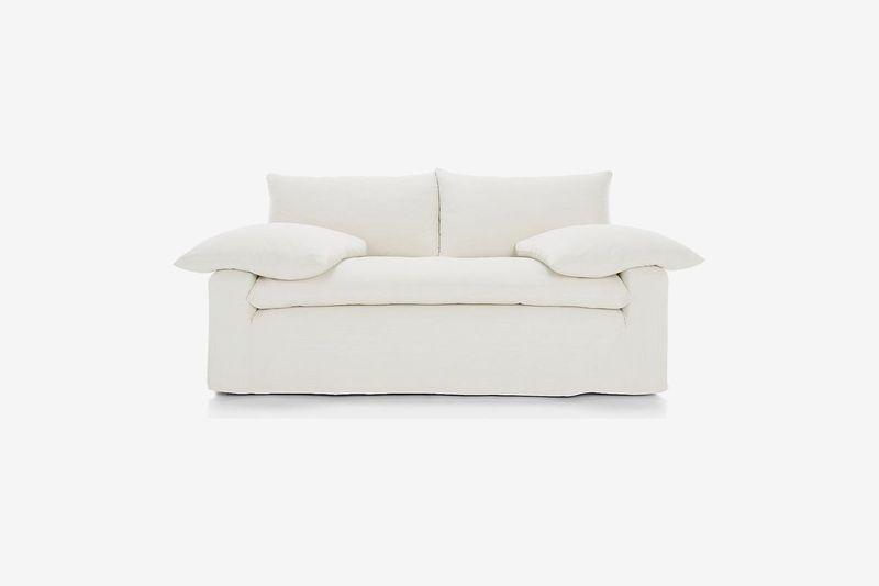 Puffy cream-colored two-seat sofa.