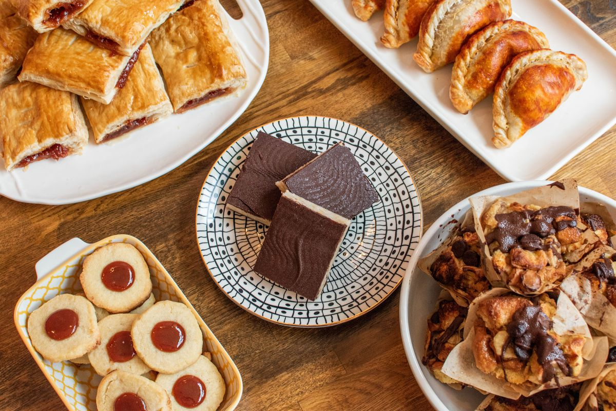 A selection of pastries from Pilar Cuban Bakery on plates of various sizes.