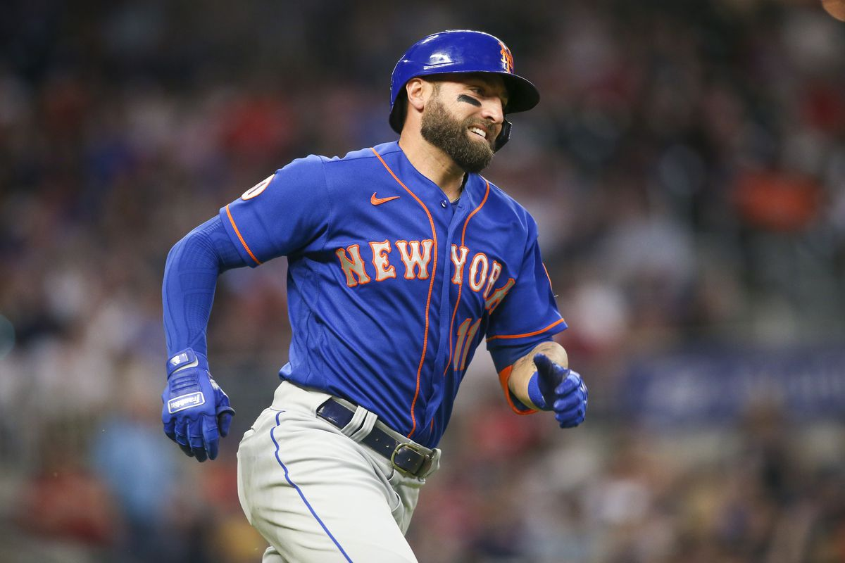 New York Mets center fielder Kevin Pillar runs to first after hitting a double against the Atlanta Braves in the sixth inning at Truist Park.