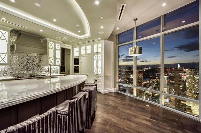 Super-fancy kitchen breakfast bar with downtown view outside floor-to-ceiling windows