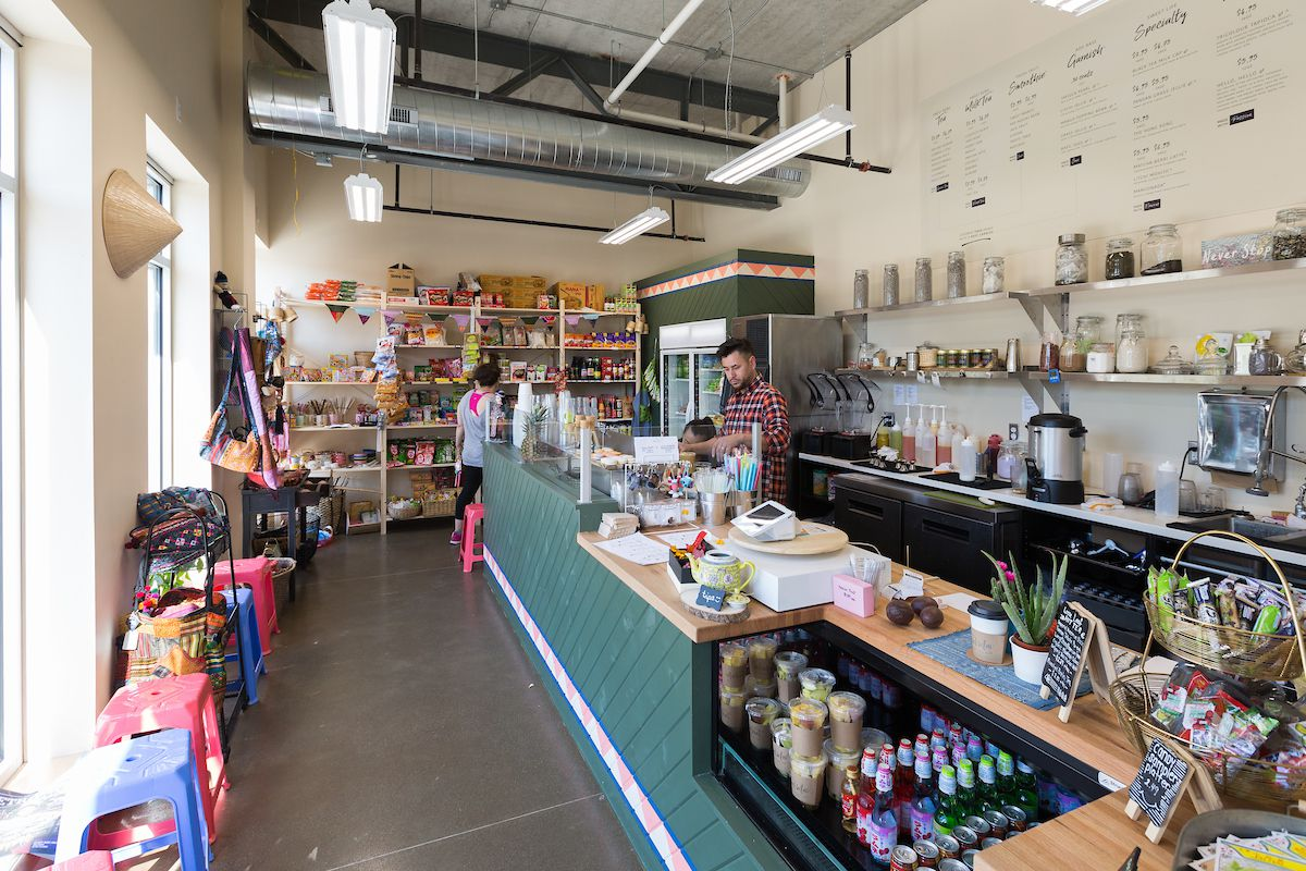 The interior of Tou & Mai has a boba tea counter and shelves on one wall full of packaged. Asian snacks and candy.