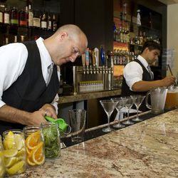 Bartenders prep drinks