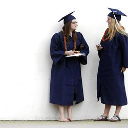 After Spring Commencement Exercises at BYU Chalay Casper, left, Mariah Hill talk Thursday, April 19, 2012 at the Marriott Center.