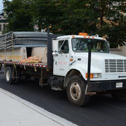 Mon 4:38 p.m. Midwest Fence truck leaving the ballpark -