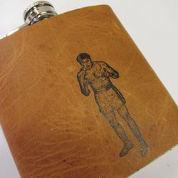 """<a href=""""http://www.etsy.com/listing/154885631/leather-flask-6oz-gift-free?ref=shop_home_active"""">Handpainted Leather Flask</a>, $22. Available via <a href=""""https://www.facebook.com/nicethingshandmade?fref=ts"""">Nice Things Handmade</a>."""