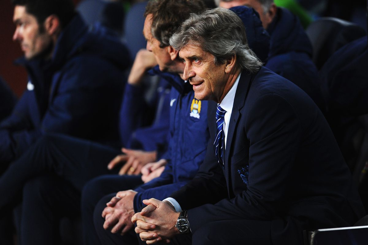 Pellegrini watches as his side is again beaten by the Catalan giants