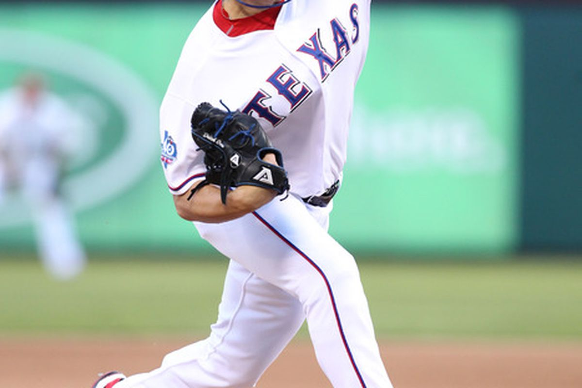 Apr 23, 2012; Arlington, TX, USA; Texas Rangers starting pitcher Derek Holland (45) pitches in the fifth inning against the New York Yankees at Rangers Ballpark.  Mandatory Credit: Matthew Emmons-US PRESSWIRE