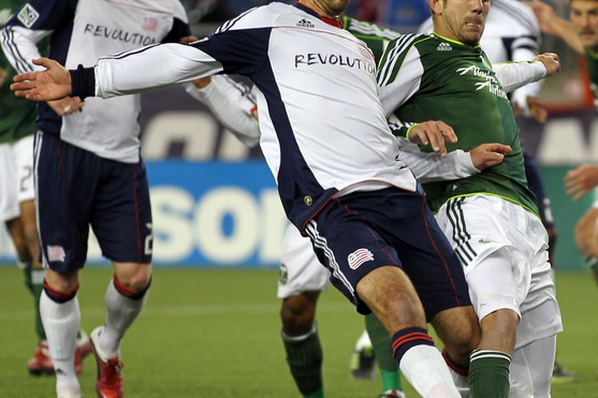 FOXBORO, MA - APRIL 2:  A. J. Soares  #5  of the New England Revolution and Eric Brunner #5 of the Portland Timbers fight for the ball at Gillette Stadium on April 2, 2011 in Foxboro, Massachusetts. (Photo by Jim Rogash/Getty Images)