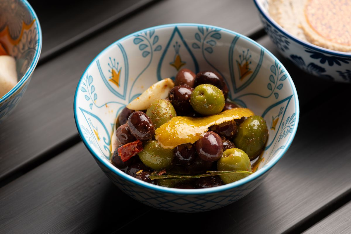 Pickled olives and other items in a bowl.