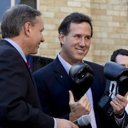 FILE - In this April 4, 2012 file photo, Republican presidential candidate, former Pennsylvania Sen. Rick Santorum, center, holds a pair of boxing gloves at a campaign stop in Hollidaysburg, Pa. Santorum is as unpopular in Pennsylvania today as he was six years ago, when home-state voters kicked him out of the Senate in a rout. That sour public perception may doom his fading chances of sticking around in the GOP presidential race, along with other hurdles that dot his path to a possible, and needed, victory in the April 24 primary.
