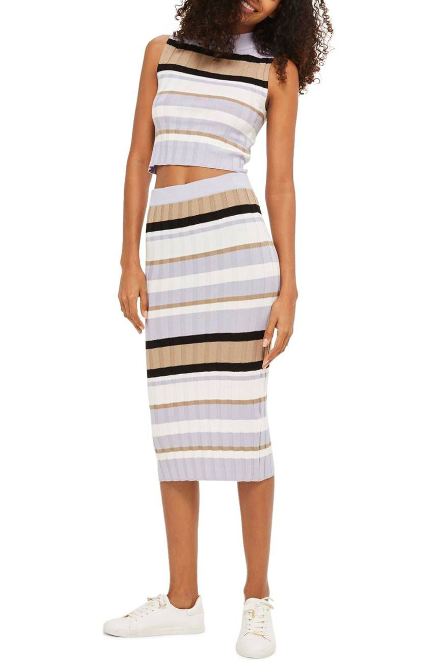 A model in a stripe knit midi skirt and crop top
